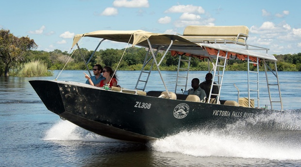 Boating on the zambezi river Zambia by Limbo Lodge.