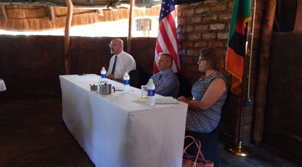 US Ambassador Eric Schultz addressing Americans resident around Livingstone. On his right is Consular Chief Otto H. Westhassel and on his left is Chief of section - Political and Economic Affairs Andrea J. Tomaszewiscz